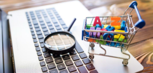 shopping-cart-alphabet-magnifying-glass-search-laptop